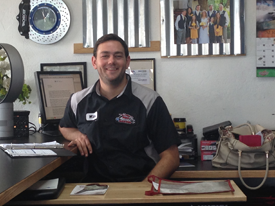 Staff member at desk inside Red Mountain Tire in Mesa, AZ