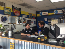 Staff members conversing at front desk inside Red Mountain Tire