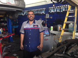 Red Mountain Tire service technician smiling