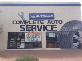 Side of Red Mountain Tire building with MICHELIN logo and tire